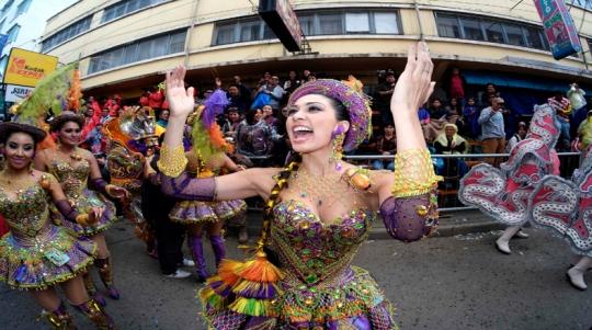 "Member of the ""Morenada Los Cocanis"" group dances during the Carnival parade in Oruro"