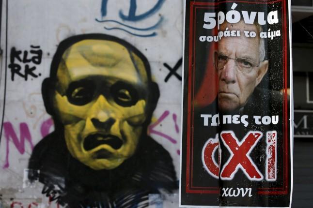O ministro das Finanças alemão, Wolfgang Schäuble, numa parede em Atenas REUTERS/YANNIS BEHRAKIS