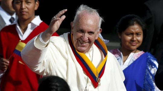 Pope Francis waves while wearing a neck sash in Ecuador's national colours after he landed in Quito, Ecuador, July 5, 2015. Pope Francis landed in Ecuador's capital Quito on Sunday to begin an eight-day tour of South America that will also include visits to Bolivia and Paraguay. On his first visit as pontiff to Spanish-speaking Latin America, the Argentina-born pope is scheduled to conduct masses in both Quito and the coastal city of Guayaquil before flying to Bolivia on Wednesday. REUTERS/Jose Miguel Gomez